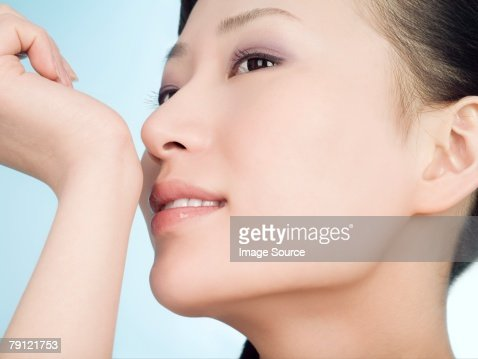 Woman smelling wrist : Stock Photo