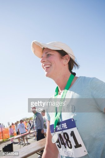Woman smiles after completing race