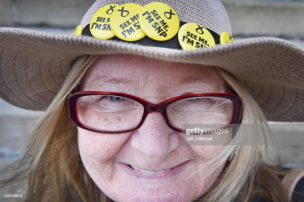 A woman smiles as SNP supporters gather to listen to party leader and First Minister Nicola Sturgeon holding her final party rally in Buchanan Street on May 4, 2016 in Glasgow, Scotland. Political party leaders will embark on the final day of campaigning in a bid to win over voters on the eve of the Scottish Parliament election.