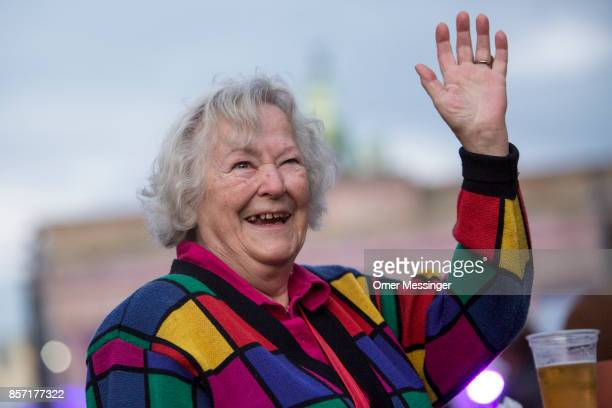A woman smiles at an amusement area set up along 17th of June Street in Tiergraten Park near the Brandenburg Gate on German Unity Day on October 3...