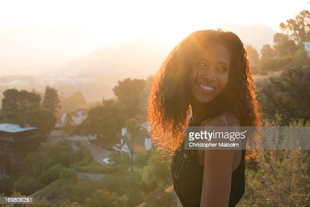 Woman smiles at sunrise