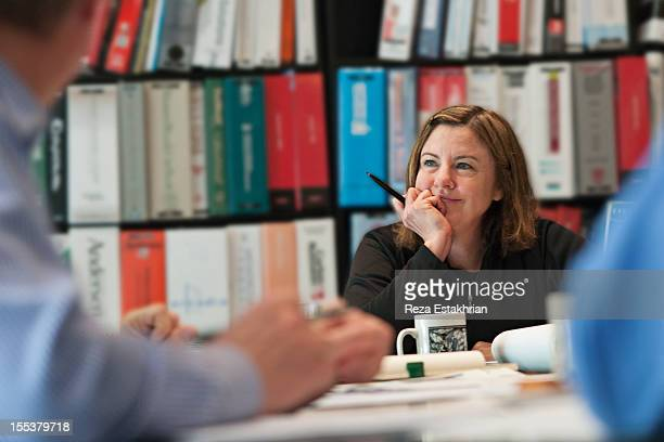Woman smiles during meeting
