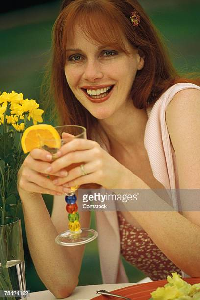 Woman smiling and drinking a cocktail