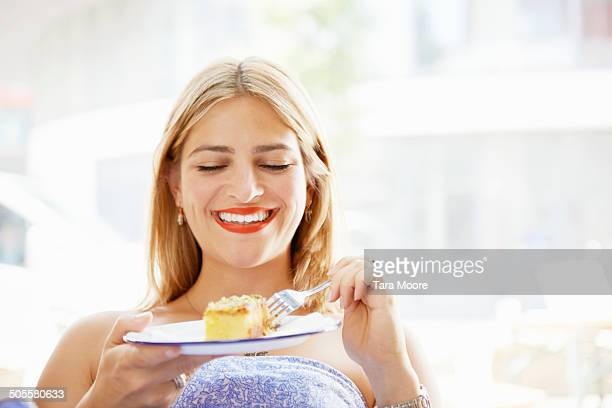woman smiling and eating cake