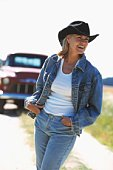 Woman smiling and wearing cowboy hat