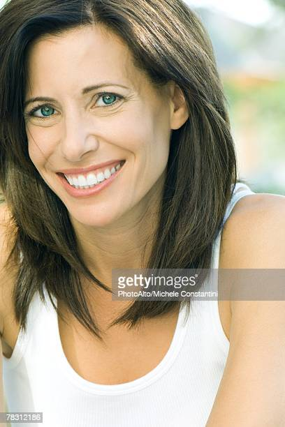 Woman smiling at camera, portrait