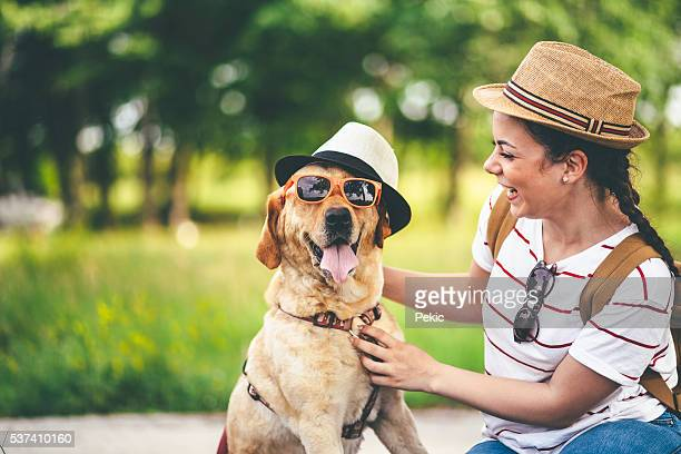 Woman smiling at her funny dog