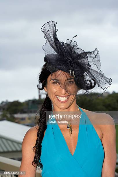 Woman smiling at the races