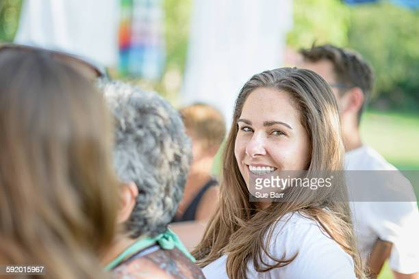 Woman smiling at tomato eating festival