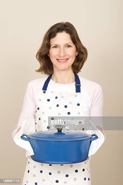 Woman smiling because she knows how easy crock pots are.