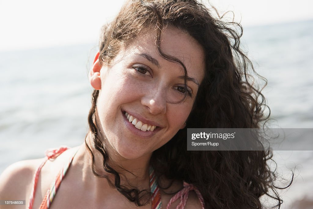Woman smiling by water : Stock Photo