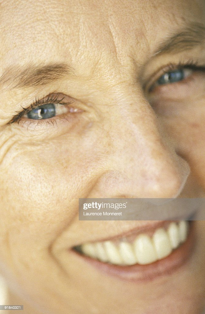 Woman smiling close-up : Stock Photo