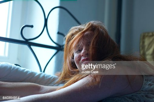 woman smiling despicable at her partner in bed