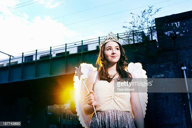 woman smiling dressed as fancy dress fairy