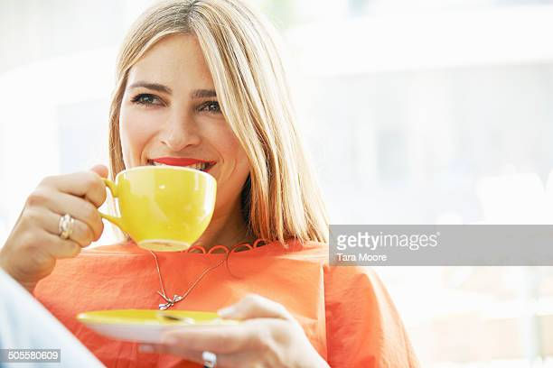 woman smiling drinking coffee
