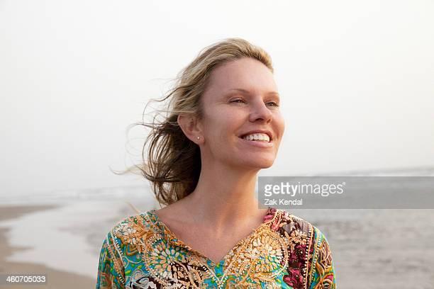 Woman smiling enjoying sea breeze