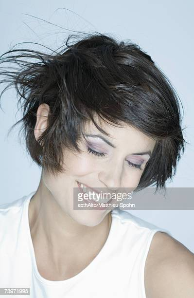 Woman smiling, hair blowing