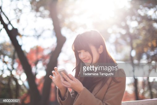 Woman smiling in a nature : Stock Photo
