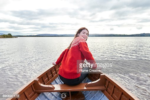 Woman smiling in a row boat