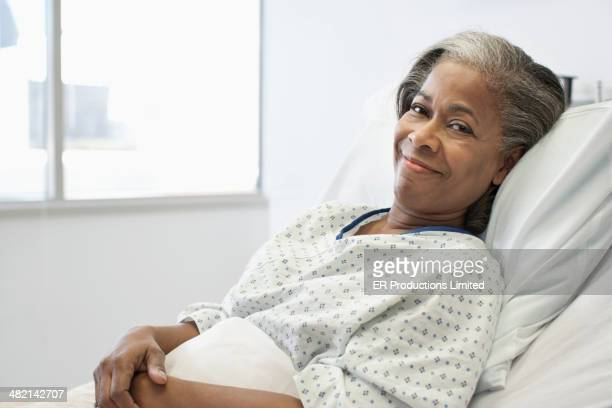 Woman smiling in hospital bed