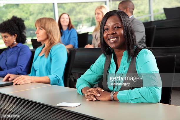 Woman smiling in lecture auditorium