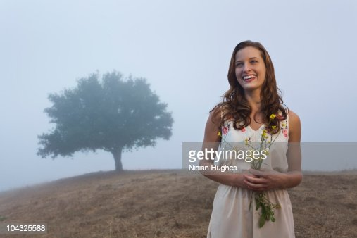 woman smiling in nature : Stock Photo