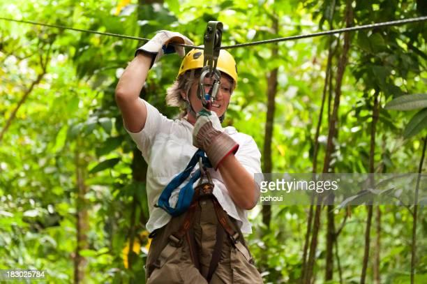 Woman smiling in zipline, Costa Rica jungle
