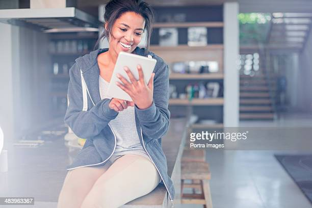 Woman smiling looking at a digital tablet