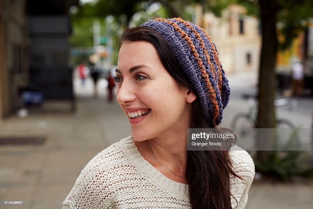 Woman smiling on city street : Stock Photo
