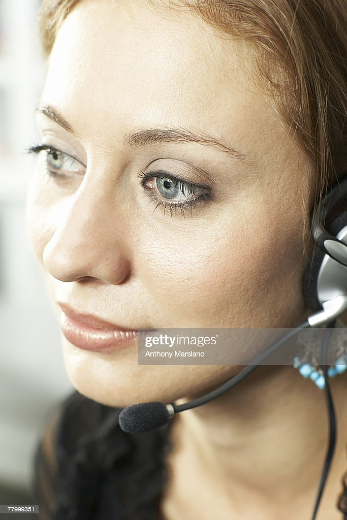 Woman smiling on headset : Stock Photo