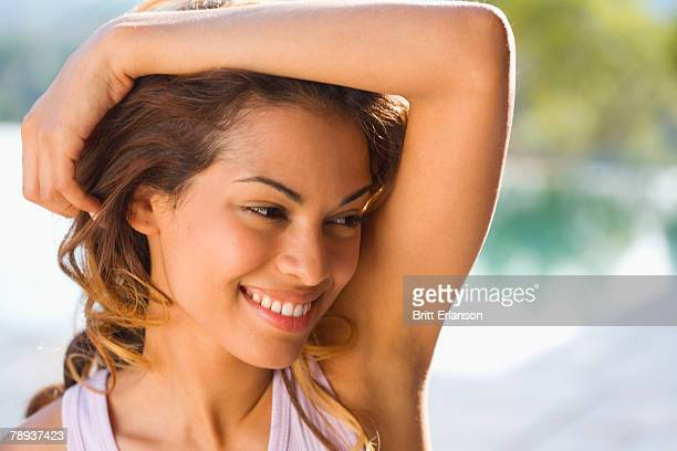 Woman smiling outdoors.