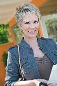 Woman smiling outdoors, portrait