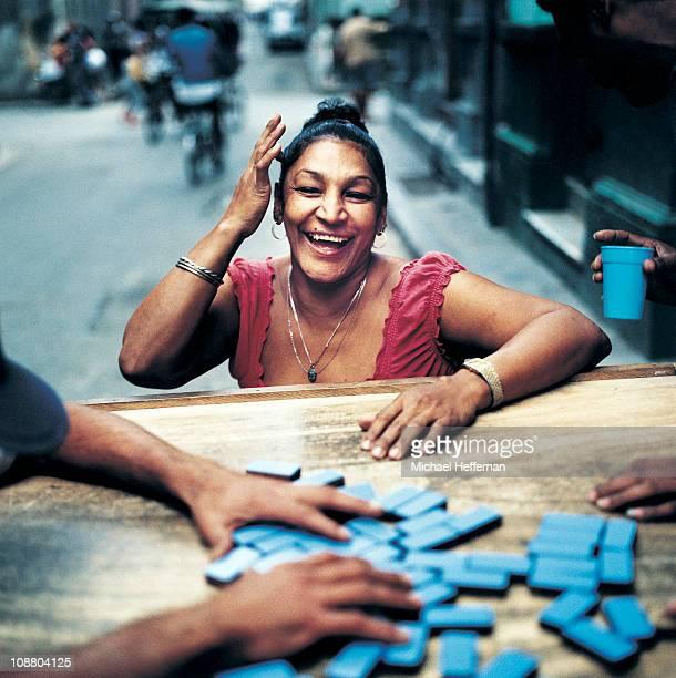 Woman smiling playing dominos Havana