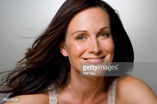 Woman smiling, portrait, close-up : Foto stock