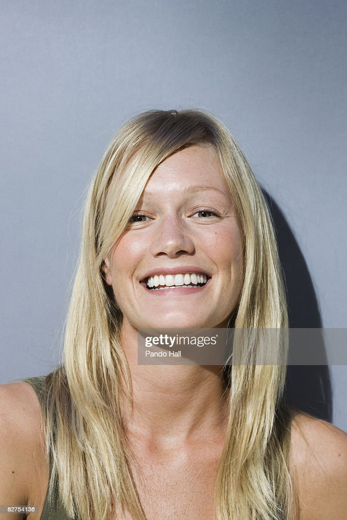 Woman smiling, portrait : Stock Photo