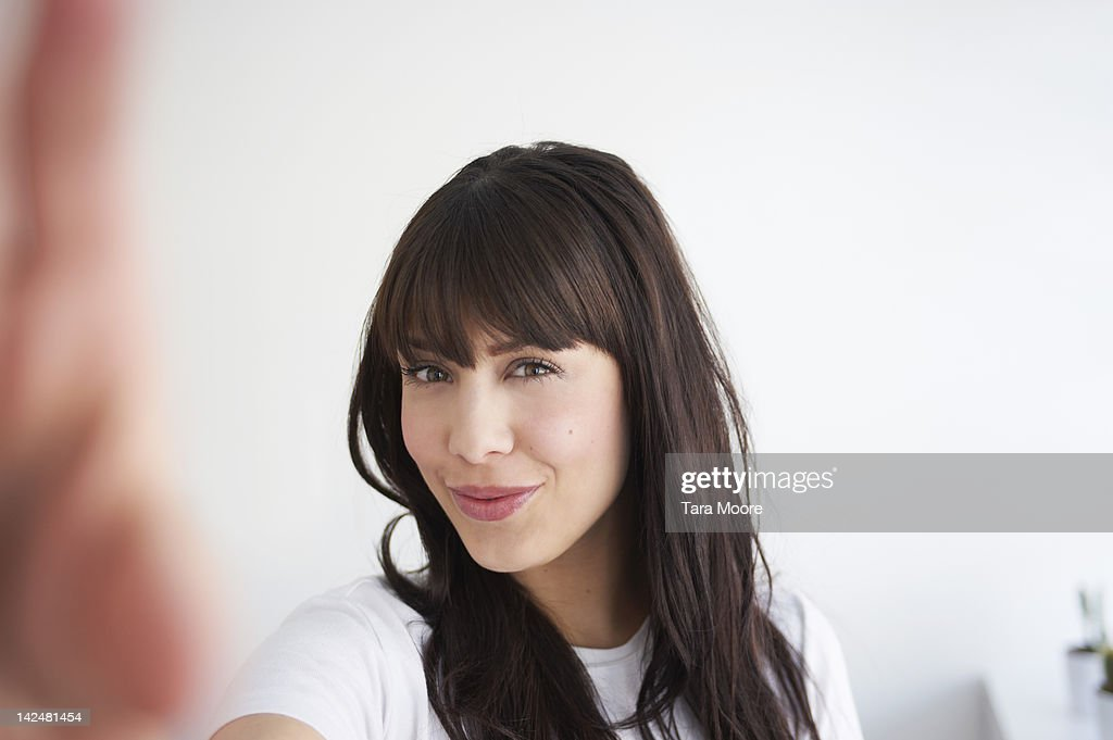 woman smiling taking self portrait : Stock Photo