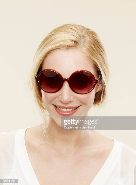 woman smiling whilst wearing glasses