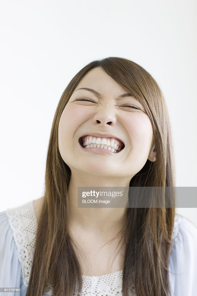 Woman smiling with eyes closed : Stock Photo