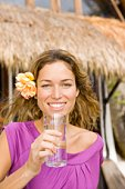 Woman smiling with glass of water