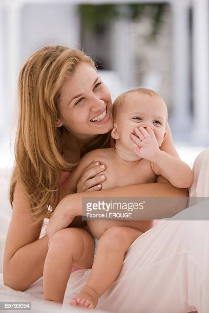 Woman smiling with her daughter