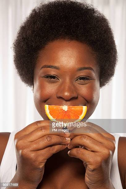 Woman smiling with orange slice