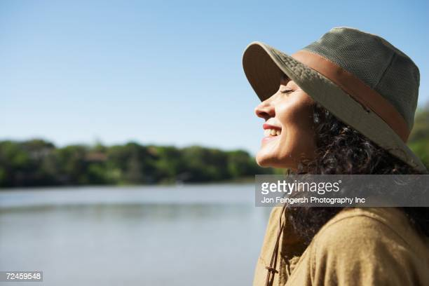 Woman smiling with sun on her face