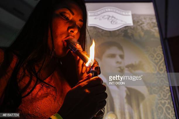A woman smokes a cigar during 'Puro Humo' at the IV International Tobacco Festival in Managua on January 14 2015 Some experts now maintain that...