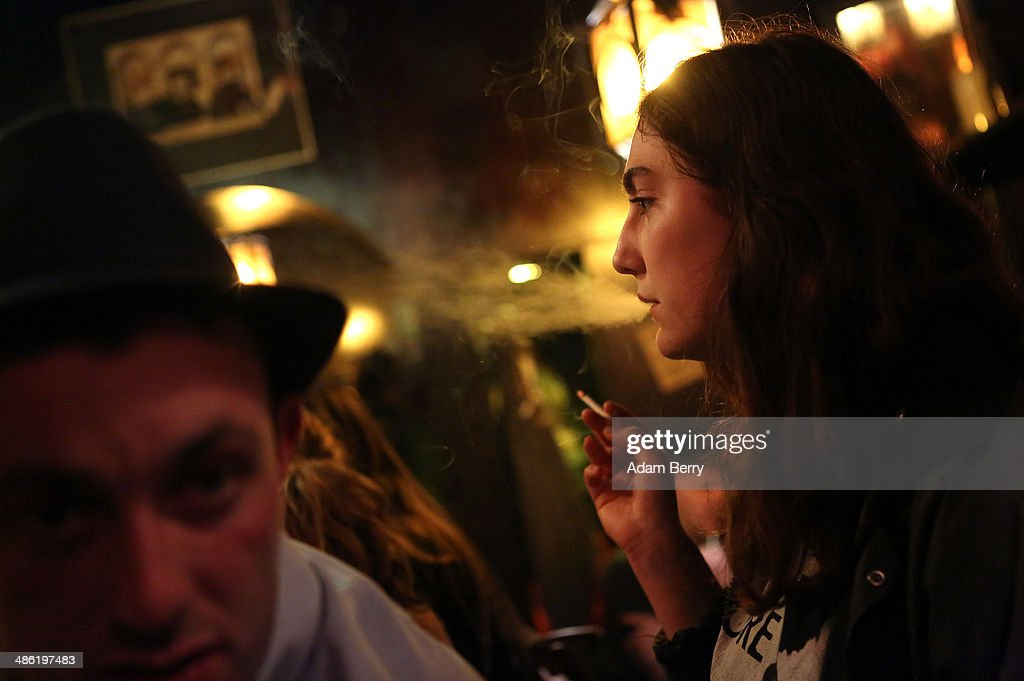 A woman smokes a cigarette at the Alt Berlin (Old Berlin) bar on April 22, 2014 in Berlin, Germany. The bar, which opened in 1893 and is known for its familial atmosphere, is claimed to be the oldest bar in the German capital, a city with few remaining pre-War drinking establishments in comparison to other major European cities. A petition has been launched to convince the bar's landlord to allow the business to stay open after its expected closure at the end of the month due to skyrocketing real estate prices in the city's popular and central Mitte neighborhood.