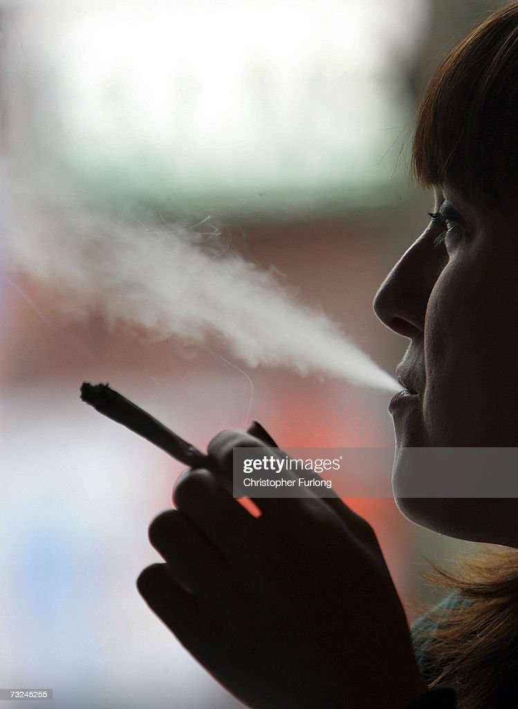 A woman smokes a cigarette of marijuana in an Amsterdam cafe on February 7, 2007 in Amsterdam, Netherlands. The city council in Amsterdam has recently voted in favour of introducing a citywide ban on smoking marijuana in public areas. A successful trial ban in the De Baarsjes district of Amsterdam has been declared a success after a reduction in anti social behaviour.