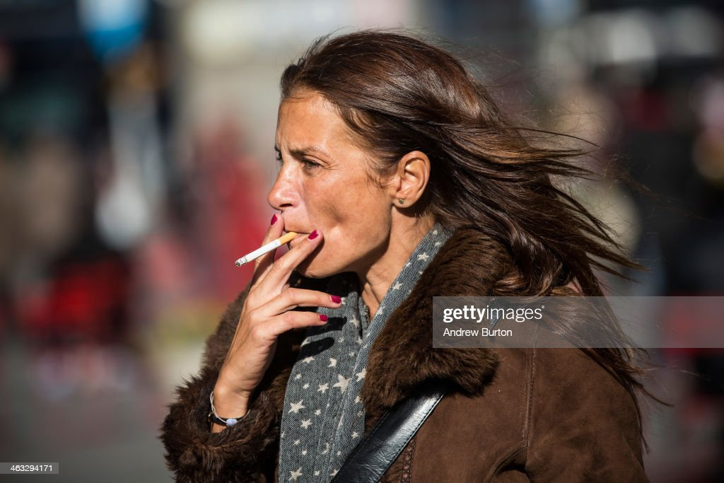A woman smokes a cigarette on January 17 2014 in Times Square in New York City A new report from the Surgeon General shows the that list of negative...