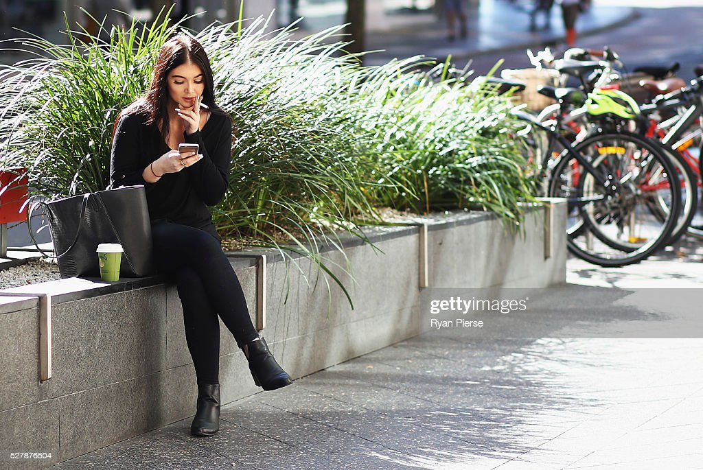 A woman smokes a cigarette on May 04, 2016 in Sydney, New South Wales. The Australian Government yesterday announced in their budget four annual 12.5 per cent increases to tobacco excise and excise equivalent customs duties which will significantly push up the over-the counter price up to AUD$40 by 2020.