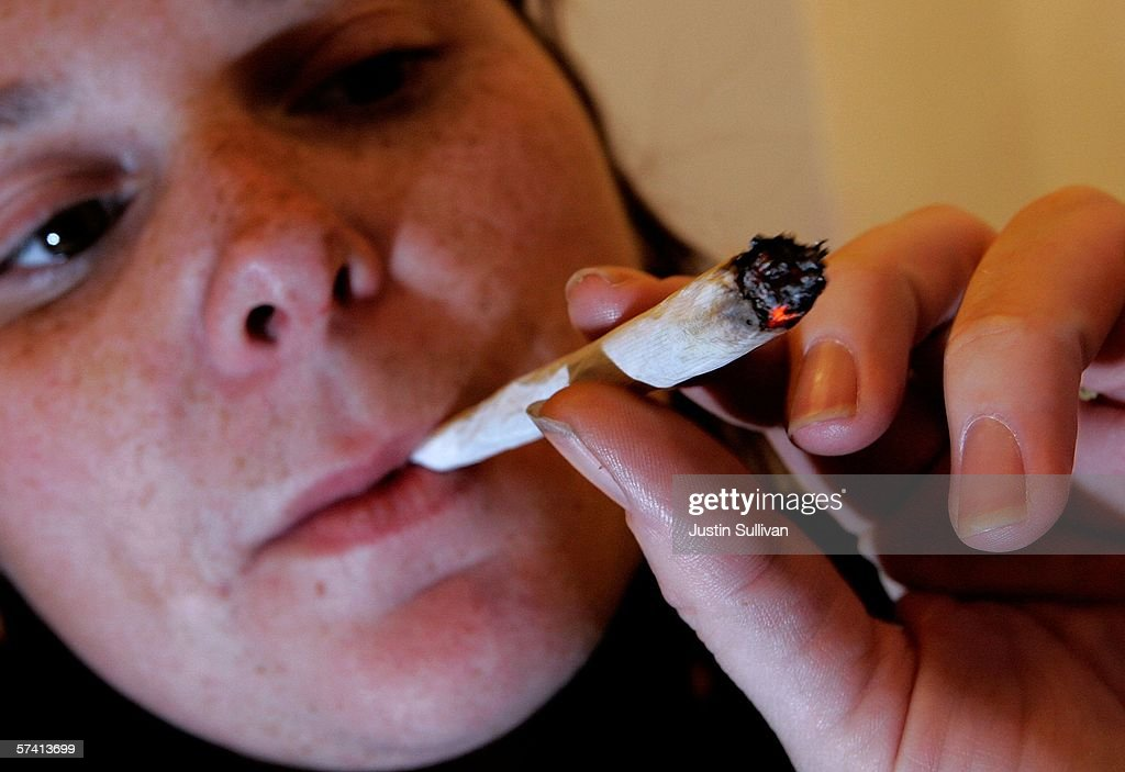 A woman smokes a marijuana cigarette at the Alternative Herbal Health Services cannabis dispensary April 24, 2006 in San Francisco, California. The Food and Drug Administration issued a statement last week rejecting the use of medical marijuana declaring that there is no scientific evidence supporting use of the drug for medical treatment.
