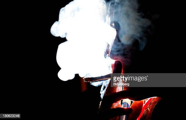 A woman smokes a marijuana cigarette in Toronto Ontario Canada on Wednesday Oct 26 2011Ontario is one step closer to the legalization of marijuana...