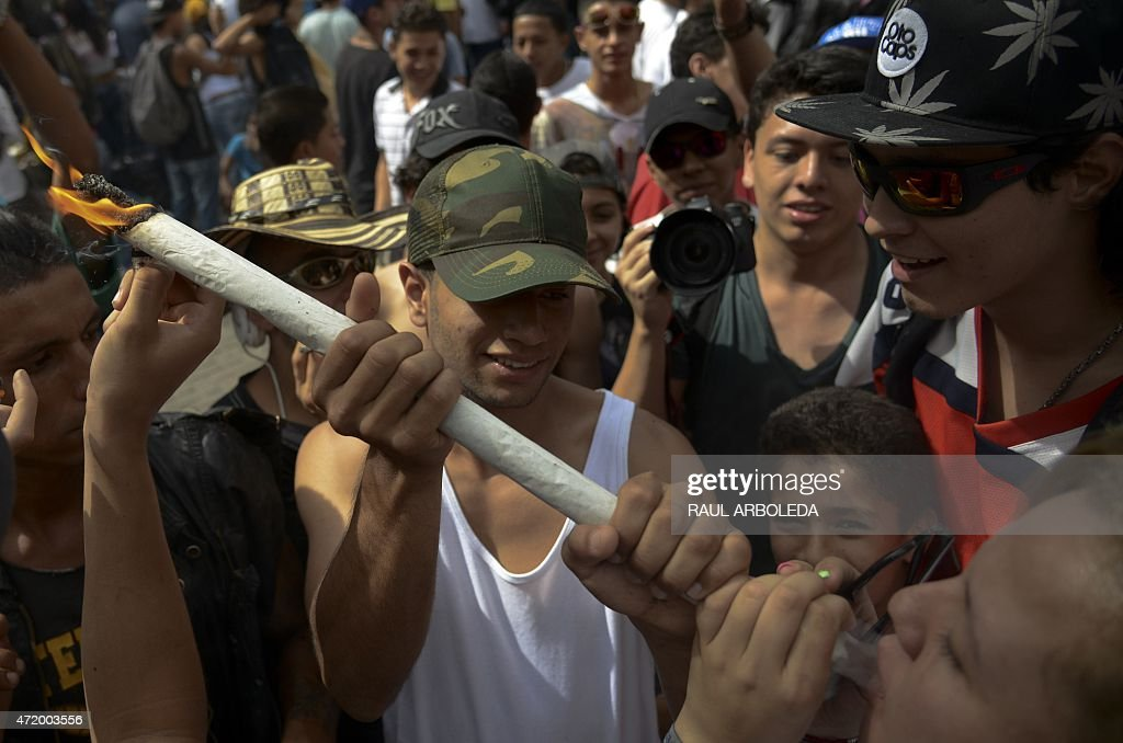 A woman smokes marijuana during a demo for its legalization, in Medellin, Antioquia department, Colombia on May 2, 2015. The demo is against drug trafficking and for the self-cultivation for medicinal and recreational purposes. AFP PHOTO/Raul ARBOLEDA